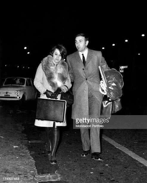 Italian TV presenter Pippo Baudo walking with his fiancèe Angela Lippi Milan 1970