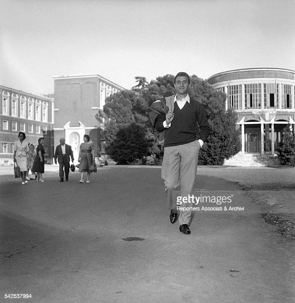 Italian TV presenter that made the history Pippo Baudo walking in the street of the capital Rome Italy 1960