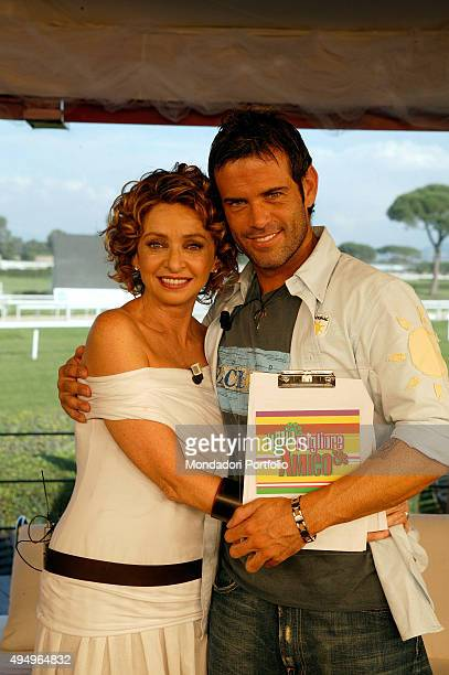 Italian Tv presenters Enrica Bonaccorti and Ascanio Pacelli posing hugging each other for a photo shooting shooted in the TV studio of the show 'Il...