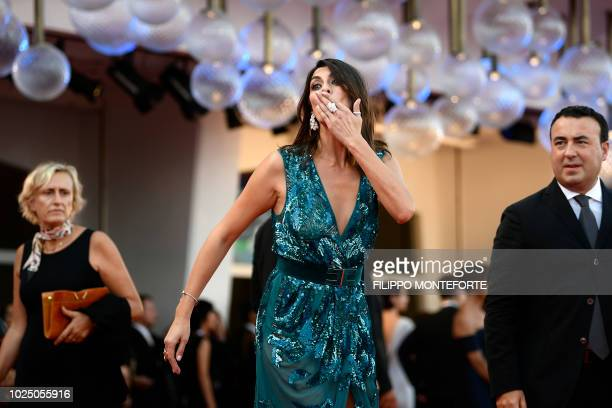 Italian tv show host and companion of Italy's Interior minister Elisa Isoardi arrives for the opening ceremony of the 75th Venice Film Festival on...