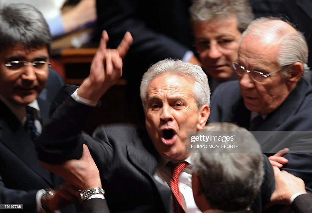 Italian UDEUR senator Tommaso Barbato gestures against the Catholic UDEUR senator Sergio Cusumano at the Senate in Rome 24 January 2008. Italian Prime Minister Romano Prodi put his political survival on the line, calling for a vote of confidence in his centre-left government after 20 months in power. The crisis was sparked by the withdrawal of the centrist UDEUR party.
