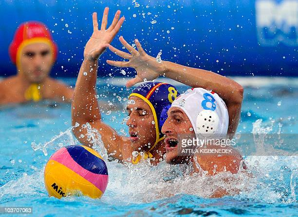 Italian Valentino Gallo fights for the ball with Spanish Albert Espanol in the Mladost venue swimming pool of Zagreb on August 29 2010 during their...