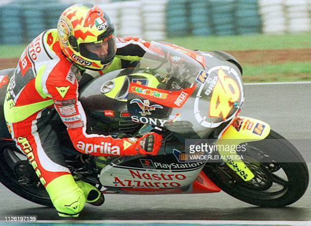 Italian Valentino Rossi rides his 250cc Aprilia during a practice session at the Nelson Piquet speedtrack in Rio de Janeiro Brazil 22 October 1999 in...