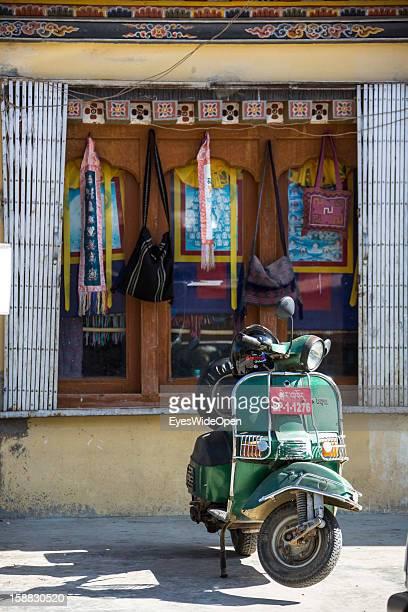 A italian Vespa motorbike in front of a shop on November 18 2012 in Thimphu Bhutan