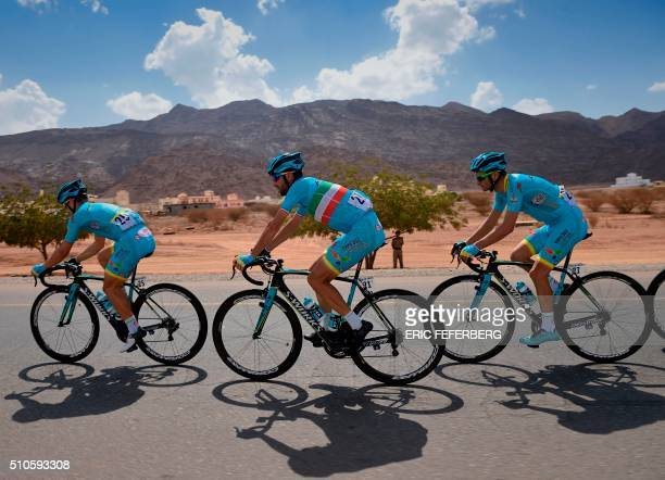 TOPSHOT Italian Vincenzo Nibali rides with Astana teammates Italian Andrea Guardini and Italian Michele Scarponi during the first stage of the 7th...