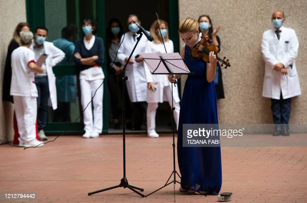 Italian violinist Fiamma Flavia Paolucci performs at Tor Vergata Hospital in Rome on May 12 as the world is marking International Nurses Day during...