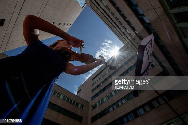 TOPSHOT Italian violinist Fiamma Flavia Paolucci performs at Tor Vergata Hospital in Rome on May 12 as the world is marking International Nurses Day...