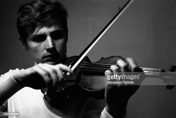 Italian violinist Uto Ughi playing the violin Val Badia January 1970