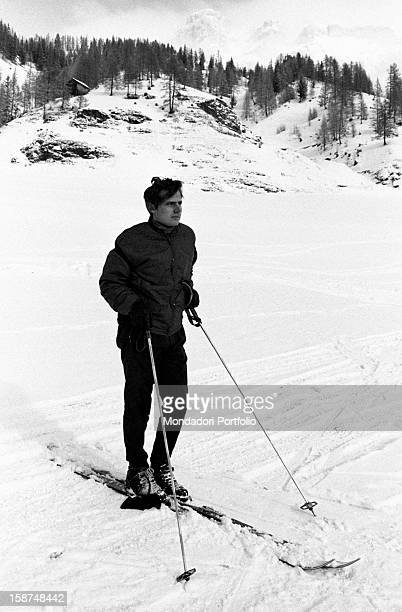 Italian violinist Uto Ughi posing on a ski run Val Badia January 1970