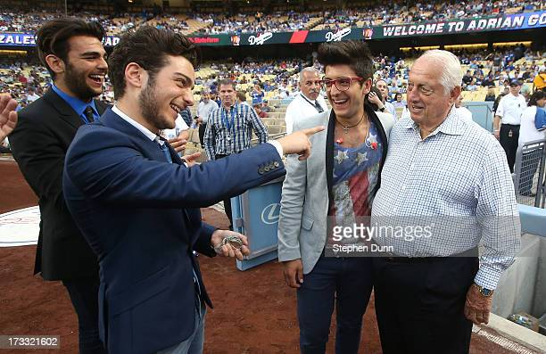 Italian vocal group Il Volo Ignazio Boschetto Gianluca Ginoble and Piero Barone meet Dodger legend Tommy Lasorda before the game between the Colorado...