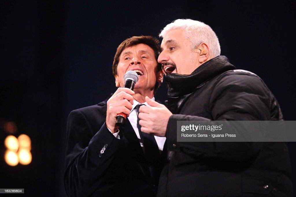 Italian vocalist Gianni Morandi (L) and musician and author Pino Daniele (R) performs the Lucio Dalla Tribute at Piazza Maggiore on March 4, 2013 in Bologna, Italy.