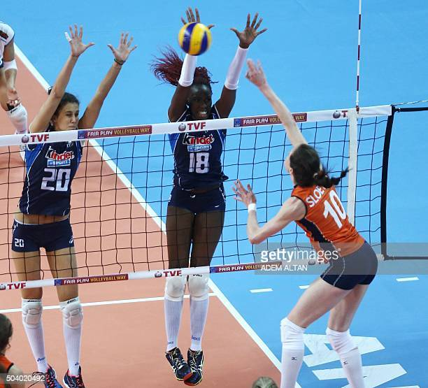 Italian volleyball players Anna Danesi and Paola Ogechi Egonu attempt to block Dutch player Lonneke Sloetjes as she smashes during the European...