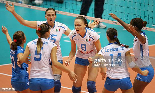 Italian volleyball players cheer after scoring against Serbia at the women's World Cup volleyball tournament at the Namihaya Dome in Kadoma, Osaka...