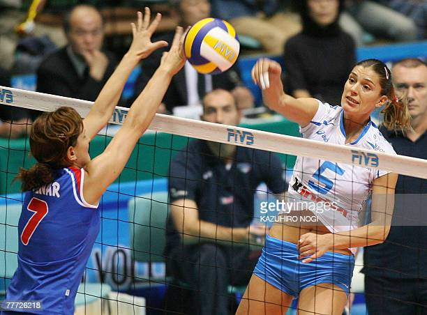 Italian volleyball star Francesca Piccinini spikes the ball past Serbian blocker Brizitka Mohnar during their second round match at the women's World...