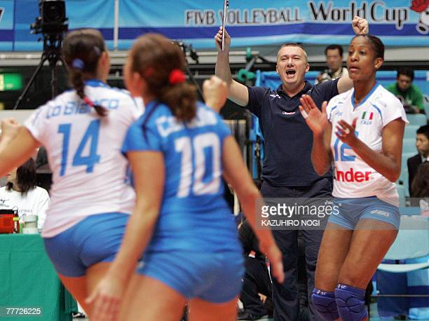 Italian volleyball team head coach Massimo Barbolini and his players celebrate their victory over Serbia at the women's World Cup volleyball...