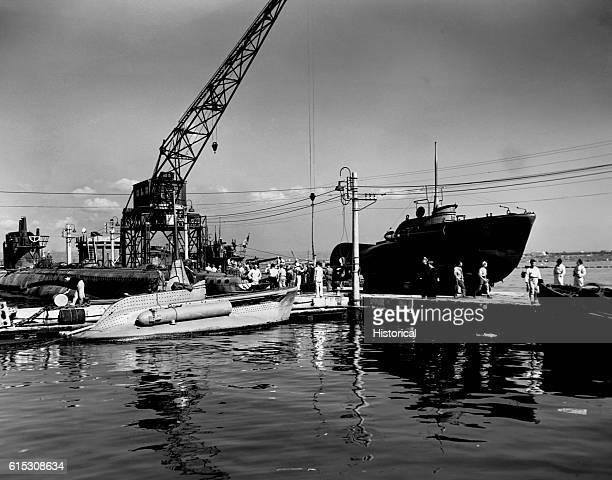 Italian warships surrendered at Taranto Italy including an Italian midget submarine with its torpedo tube fixed to the side November 17 1943