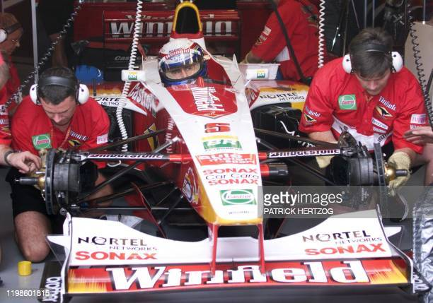 Italian WilliamsSupertec driver Alessandro Zanardi seats in his car as his mecanics repar the breackes in the pits of the racetrack during the first...