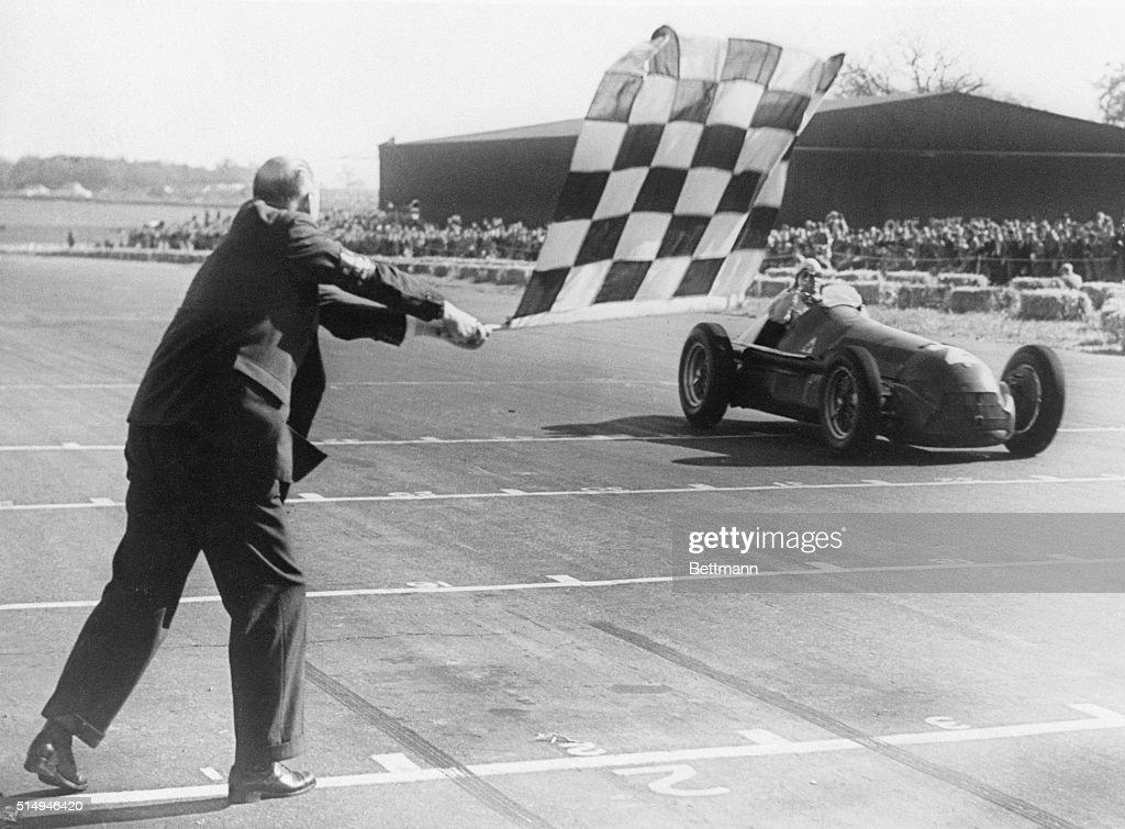 Giuseppe Farina Crossing Finish Line in Racing Car : News Photo