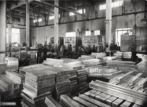 Italian workers working at Bolzano company Montecatini producing aluminum ingots Bolzano 1947