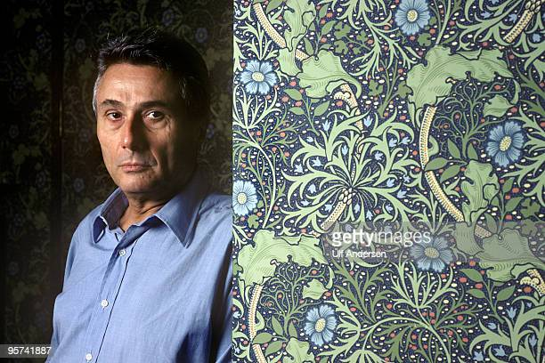 Italian writer Alberto Arbasino poses during a Portrait Session held at his home on October 19 1988 in Rome Italy