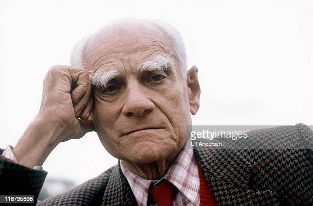 Italian writer Alberto Moravia poses at home during a portrait session held on March 25 1986 in Rome Italy