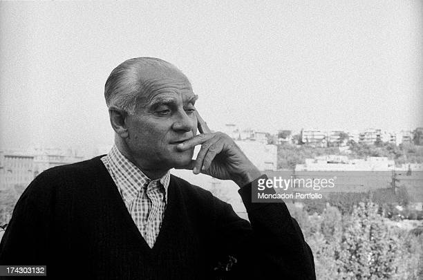 Italian writer Alberto Moravia posing with his hand on his face 1960s