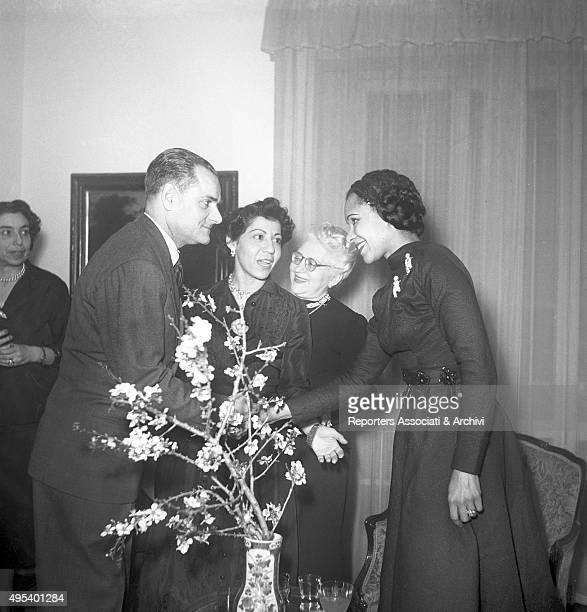 Italian writer Alberto Moravia shaking American dancer Katherine Dunham's hand 1956