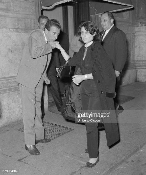 Italian writer and actor Renzo Avanzo kisses the hand of actress Anna Magnani in Via Veneto Rome 1958
