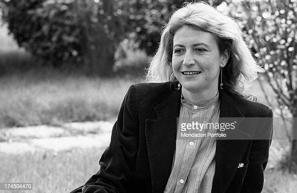 Italian writer and journalist Barbara Alberti sitting in a garden 1970s