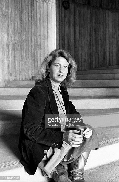 Italian writer and journalist Barbara Alberti sitting on a staircase 1970s