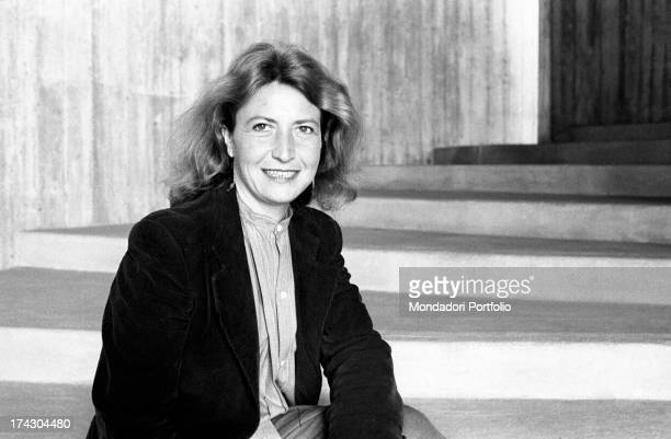 Italian writer and journalist Barbara Alberti smiling sitting on a staircase 1970s