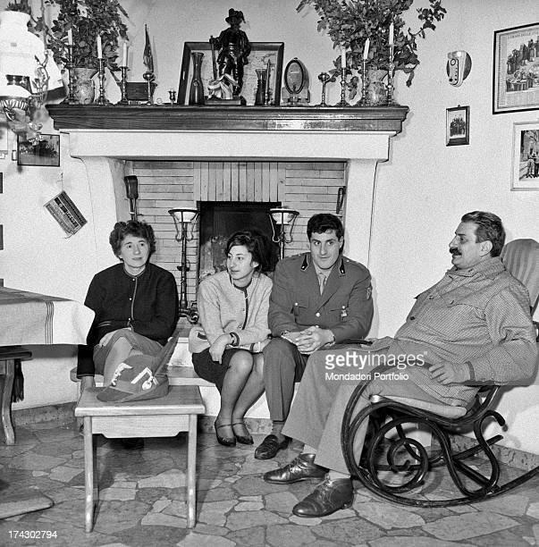 Italian writer and journalist Giovannino Guareschi sitting in the livingroom with his wife Ennia Pallini and their children Alberto and Carlotta...
