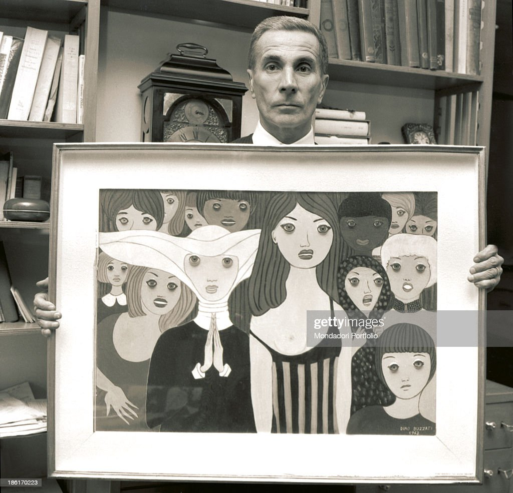 Dino Buzzati showing one of his paintings : News Photo