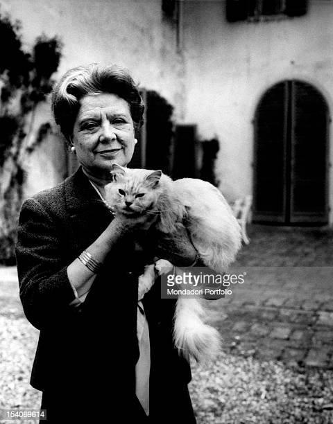 Italian writer and translator Anna Banti holding her cat 1960s