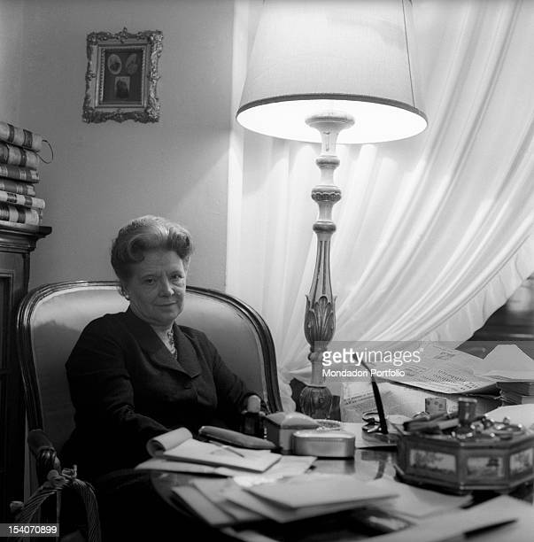 Italian writer and translator Anna Banti seated at the antique desk in her fashionable house in Florence Florence June 1962