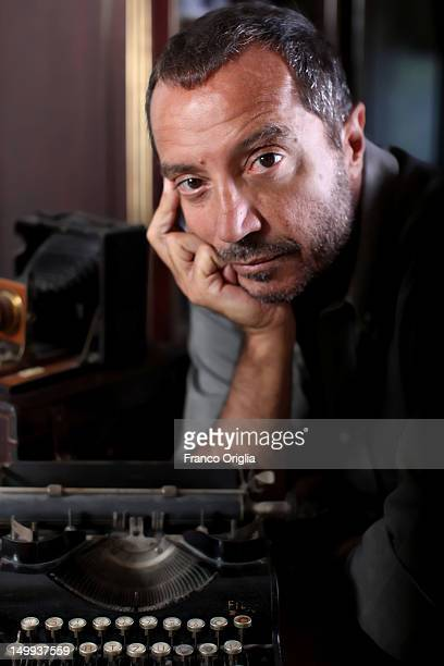 Italian writer and TV journalist Franco Di Mare poses at his home on July 26 2011 in Rome Italy