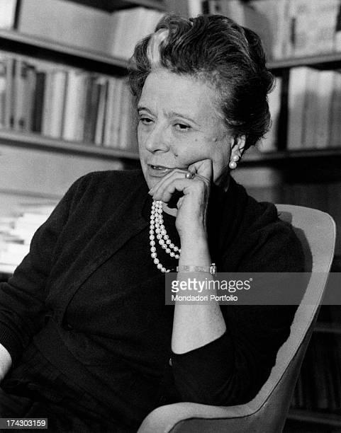 Italian writer Anna Banti sitting in an armchair 1960s