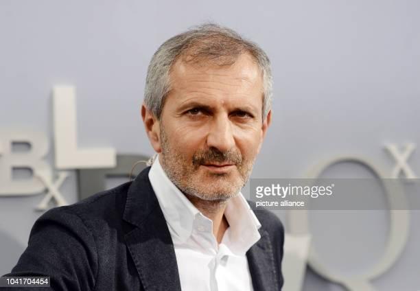 Italian writer Gianrico Carofiglio poses at the book fair in Leipzig,Germany, 18 March 2016. Photo:JENSKALAENE/dpa | usage worldwide