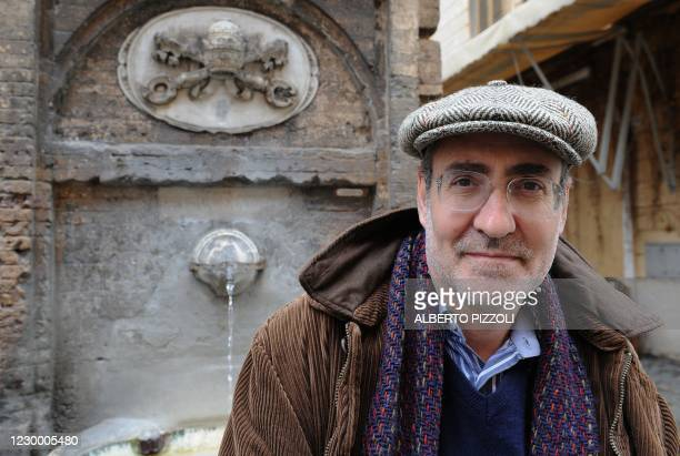 """Italian writer Marco Belpoliti poses during an interview in central Rome on March 4, 2009. Belpolti's recent book """"The body of the leader,"""" about..."""