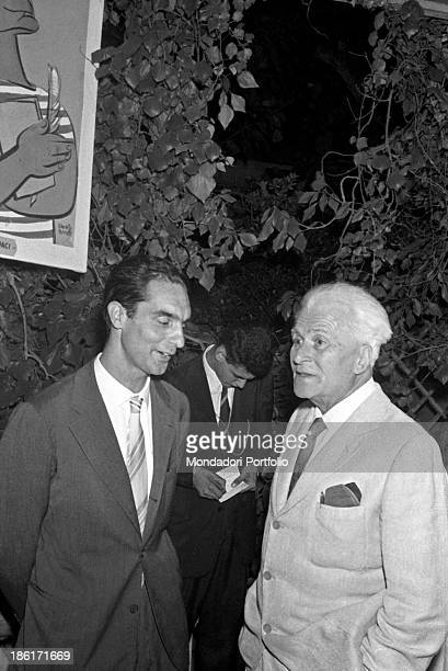 Italian writer poet and painter Leonica Repaci talking to Italian writer Italo Calvino at the Viareggio Prize Viareggio 27th August 1957