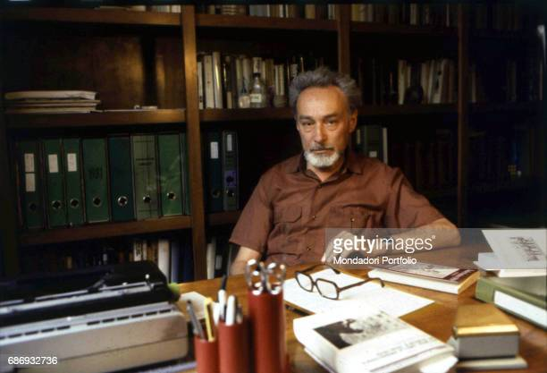 Italian writer Primo Levi sitting at a desk in his study Turin 1981