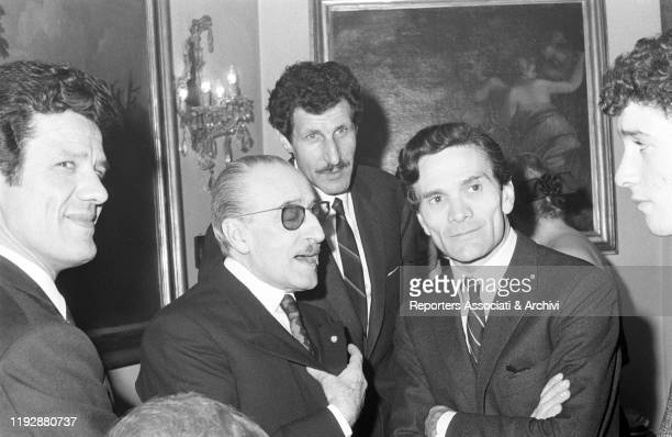 Italian writers Alberto Moravia e Pier Paolo Pasolini chatting with Italian actors Totò and Ciccio Ingrassia in the Morazzani salon Italy 1960