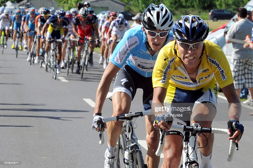 Italian yellow jersey leader Matteo Carrara (R) and Luxembourg's Franck Schleck (2ndR) ride during the 'Tour du Luxembourg' cycling race third stage between on June 05, 2010 between Eschweiler and Diekirch. France's Tony Gallopin won the stage.
