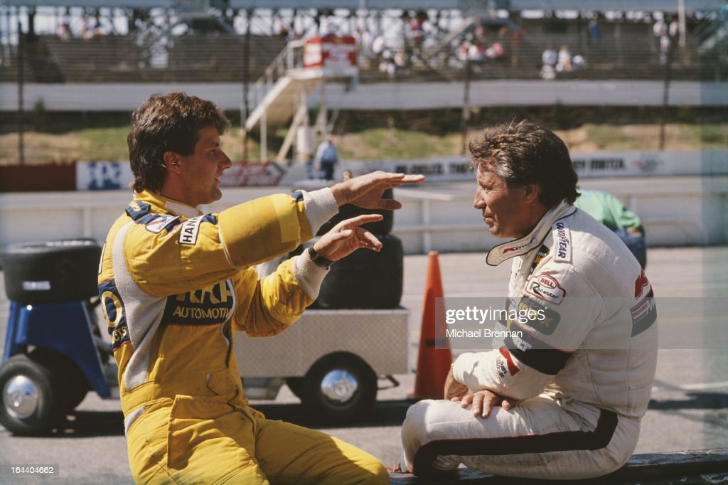 Italian-American racing driver Mario Andretti (right) with his son, Michael (left), August 21, 1988 at the CART PPG IndyCar World Series Quaker State 500 race at the Pocono International Raceway, Long Pond, PA. Michael is also a racing driver.