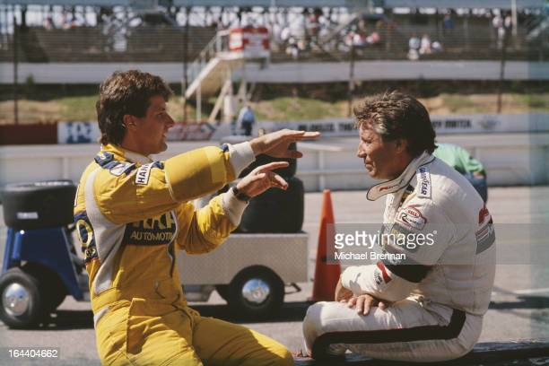 Italian-American racing driver Mario Andretti with his son, Michael , August 21, 1988 at the CART PPG IndyCar World Series Quaker State 500 race at...