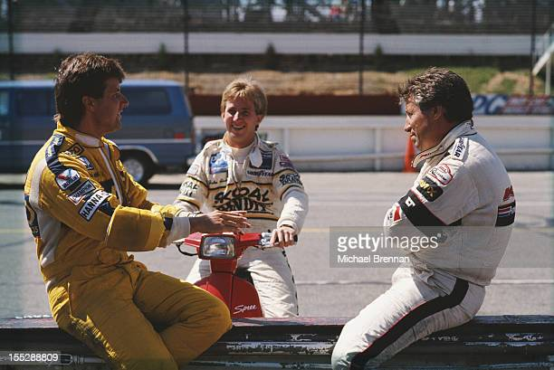 ItalianAmerican racing driver Mario Andretti with his son Michael and nephew John August 21 1988 at the CART PPG IndyCar World Series Quaker State...
