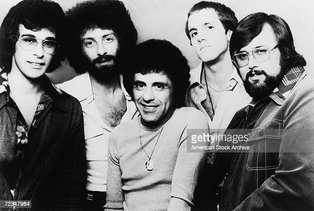 ItalianAmerican singer Frankie Valli with a late line up of The Four Seasons vocal group circa 1975 Gaudio