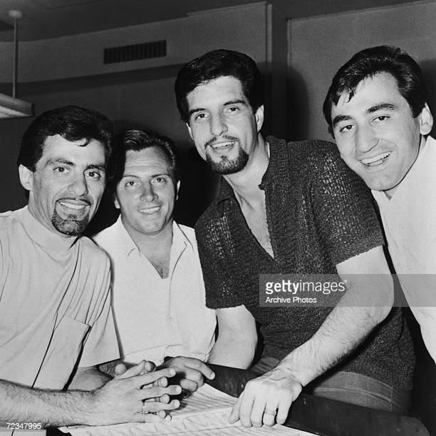 Italian-American vocal group The Four Seasons during a recording session, circa 1966. Left to right: Frankie Valli, Tommy DeVito, Bob Gaudio and Joe...