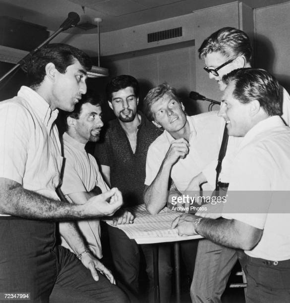 Italian-American vocal group The Four Seasons go over an arrangement during a recording session, circa 1966. Left to right: Joe Long, Frankie Valli,...