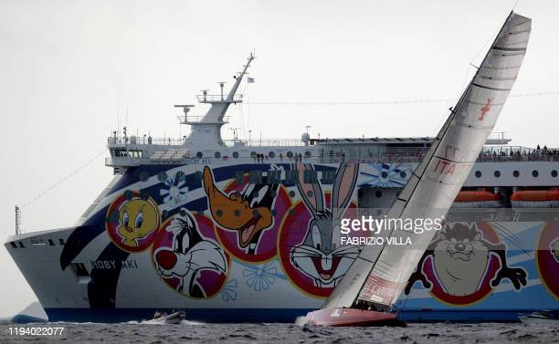 Italianan yacht Mascalzone Latino Capitalia Team passes ferry Moby Aki during their match race in the Louis Vuitton Cup's act 8 of the 32nd America's...